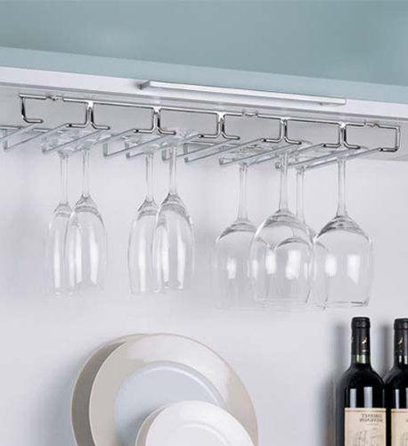 "Utilize the empty space between your cabinet and counter with <a href=""https://www.amazon.com/Organize-All-Chrome-Stemware-Holder/dp/B002L6KQSM/"" target=""_blank"">this stemware holder</a>."