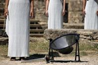 Greek actress Katerina Lehou, playing the role of High Priestess, and other prietesses stand by a parabolic mirror during the dress rehearsal for the Olympic flame lighting ceremony for the Rio 2016 Olympic Games at the site of ancient Olympia in Greece, April 20, 2016. REUTERS/Yannis Behrakis