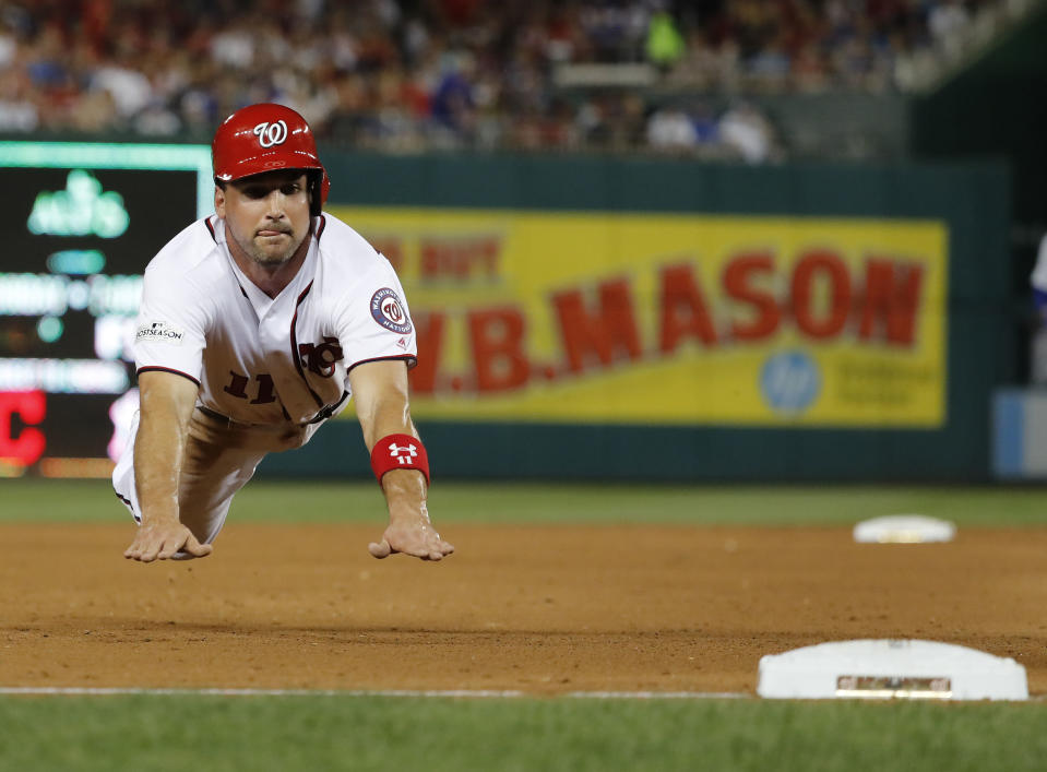 Washington Nationals' Ryan Zimmerman dives into third base during the fifth inning in Game 2 of baseball's National League Division Series against the Chicago Cubs at Nationals Park, Saturday, Oct. 7, 2017, in Washington. (AP)