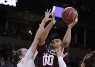 Texas A&M center Khaalia Hillsman (00) shoots over Notre Dame forward Jessica Shepard during the first half of a regional semifinal at the NCAA women's college basketball tournament, Saturday, March 24, 2018, Spokane, Wash. (AP Photo/Young Kwak)