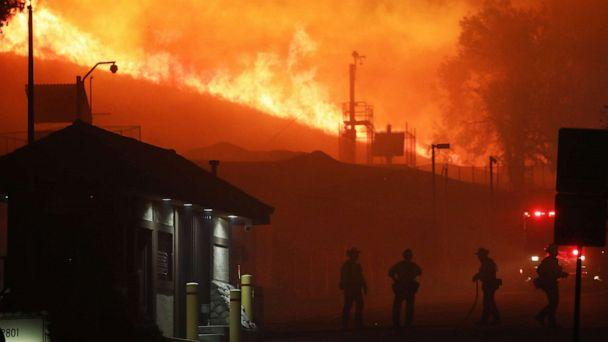PHOTO: Firefighters work as the Saddleridge Fire burns in the early morning hours on Oct. 11, 2019, in Porter Ranch, Calif. (Mario Tama/Getty Images)