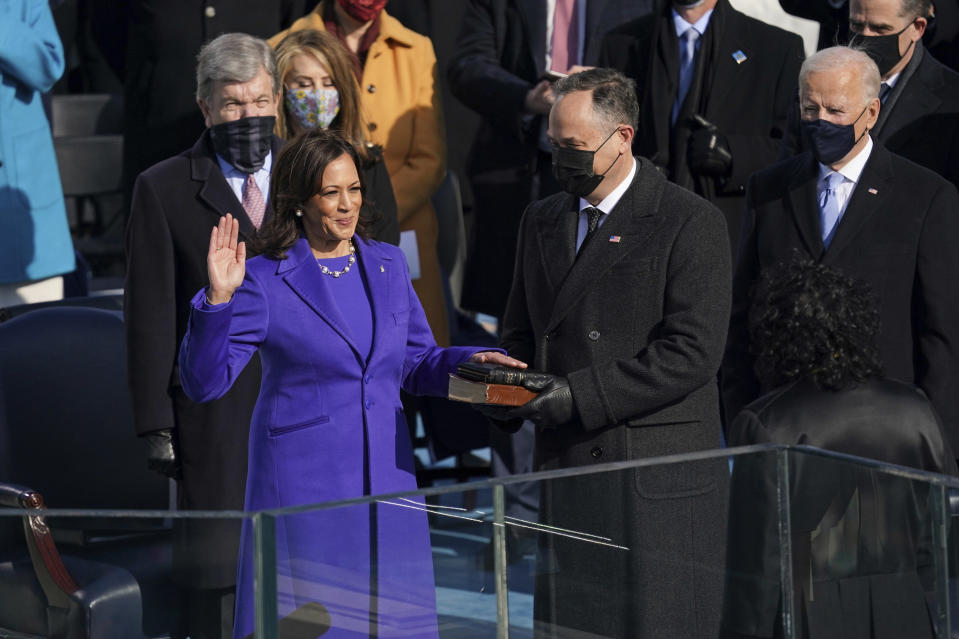 Kamala Harris is sworn in as vice president by Supreme Court Justice Sonia Sotomayor as her husband Doug Emhoff holds the Bible during the 59th Presidential Inauguration at the U.S. Capitol in Washington, Wednesday, Jan. 20, 2021. (Erin Schaff/The New York Times via AP, Pool)