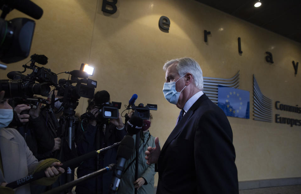 European Union's chief Brexit negotiator Michel Barnier speaks with the media at EU headquarters in Brussels, Tuesday, Dec. 22, 2020. Problems increased Monday in the bid to put a trade deal between the European Union and the United Kingdom before a Brexit transition period ends on New Year's Day, with the EU legislature insisting it will not have time to approve a deal. (AP Photo/Virginia Mayo)