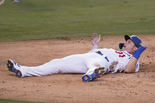 Los Angeles Dodgers' Joc Pederson protests after being called out at home plate after a single from Mookie Betts during the second inning of a baseball game against the Seattle Mariners Monday, Aug. 17, 2020, in Los Angeles. (AP Photo/Marcio Jose Sanchez)