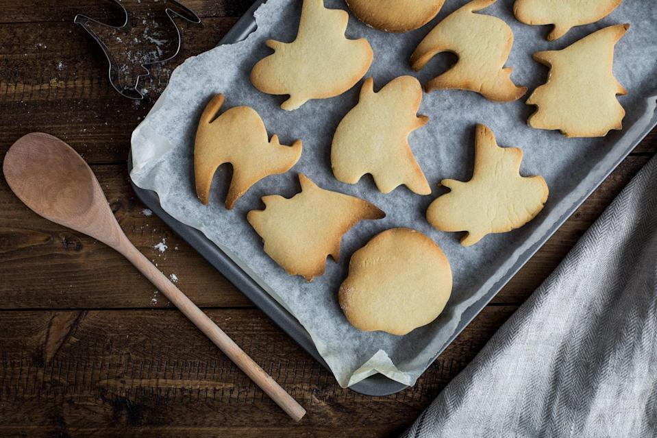 """<p>Get some ghost, cat, and pumpkin cookie cutters and bake your favorite recipe, then let the kids go nuts with the frosting and sprinkles once they're cooled off. Or, if store-bought is more your jam, grab one of these already baked <a href=""""https://www.popsugar.com/family/target-haunted-house-cookie-kit-46670853"""" class=""""link rapid-noclick-resp"""" rel=""""nofollow noopener"""" target=""""_blank"""" data-ylk=""""slk:haunted house cookie kits"""">haunted house cookie kits</a> and have your kids create personalized masterpieces. Then, display them in the kitchen so they're readily available for munching!</p>"""