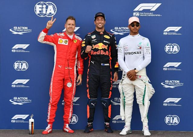 Red Bull's Daniel Ricciardo sporting his trademark smile after securing pole at Monaco in a record time (AFP Photo/Andrej ISAKOVIC)