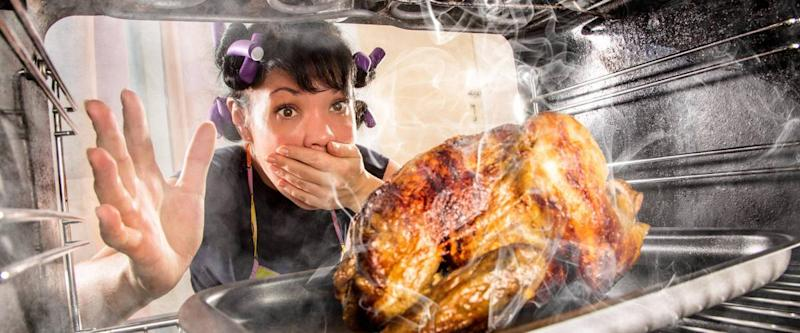 Woman finds her Thanksgiving turkey burning in her oven.