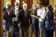 Senate Majority Leader Mitch McConnell of Ky., talks with reporters after he spoke on the Senate floor Monday, Nov. 9, 2020, at the Capitol in Washington. (AP Photo/Susan Walsh)