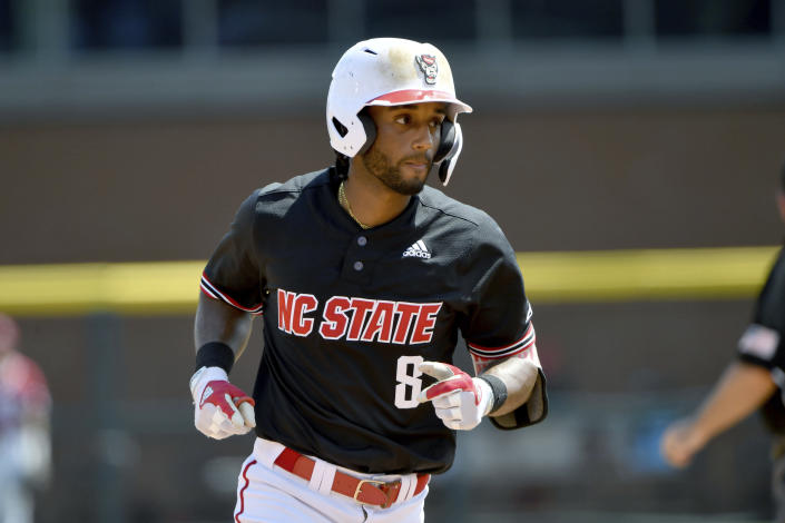 North Carolina State batter Jose Torres (8) rounds the basses after hitting a home run against Arkansas in the fourth inning of an NCAA college baseball super regional game Saturday, June 12, 2021, in Fayetteville, Ark. (AP Photo/Michael Woods)