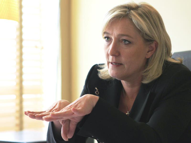 French far-right leader and National Front Party candidate for the 2012 French presidential elections, Marine Le Pen during an interview with The Associated Press at the party headquarters in Nanterre, outside Paris, Wednesday, April 18, 2012. The presidential elections will take place on April 22 and May 6, 2012. (AP Photo/Jacques Brinon)
