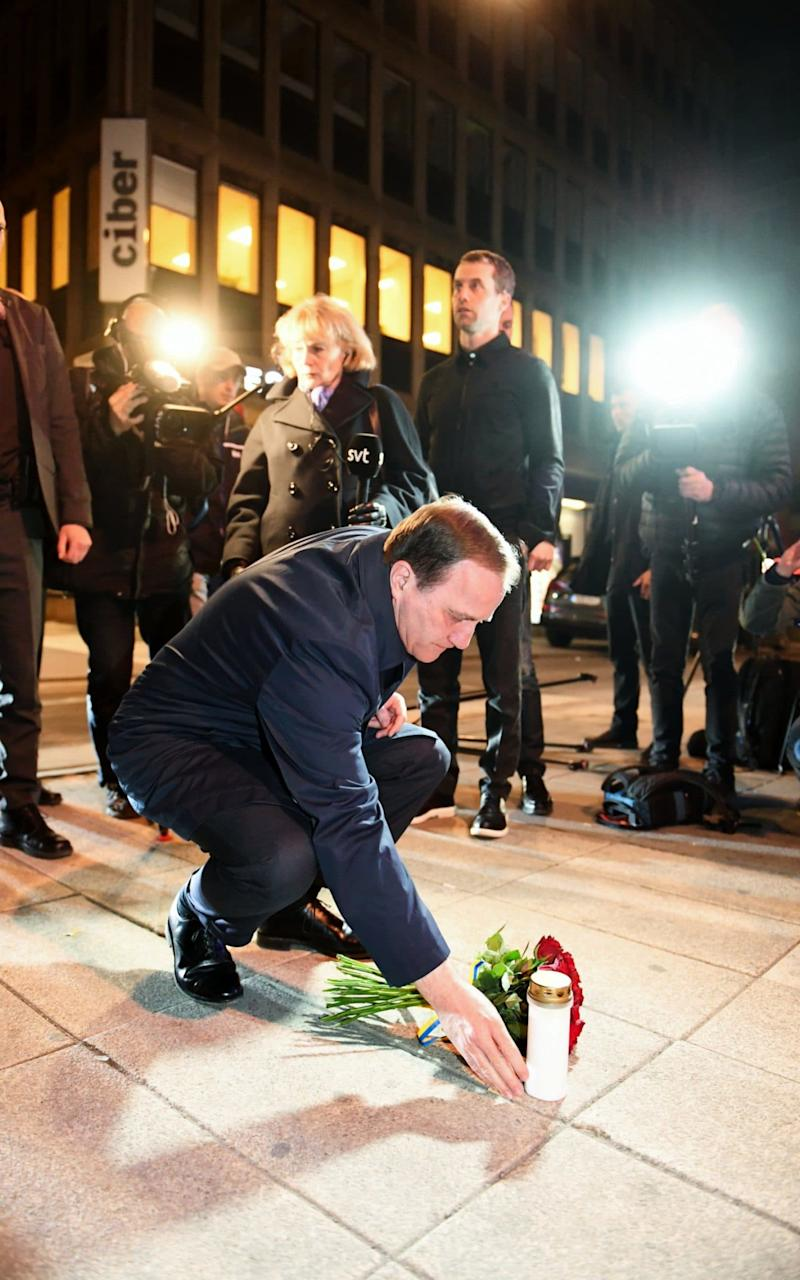 Sweden's Prime Minister Stefan Lofven place flowers at Queens Street after the terror attack on Drottninggatan - Credit: Fredrik Sandberg/TT