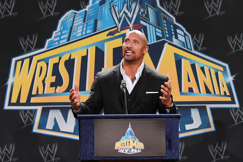 "FILE - In this Feb. 16, 2012 file photo, World Wrestling Entertainment personality Dwayne ""The Rock"" Johnson speaks at a news conference in East Rutherford, N.J. The Rock is ready to roll into WrestleMania a double champion. He's king of the box office after ""G.I. Joe: Retaliation"" took in $40.5 million over the weekend to become the No. 1 movie. He stands atop World Wrestling Entertainment as the promotion's champ heading into Sunday's April 7, 2013  WrestleMania.  (AP Photo/StarPix, Dave Allocca, File)"