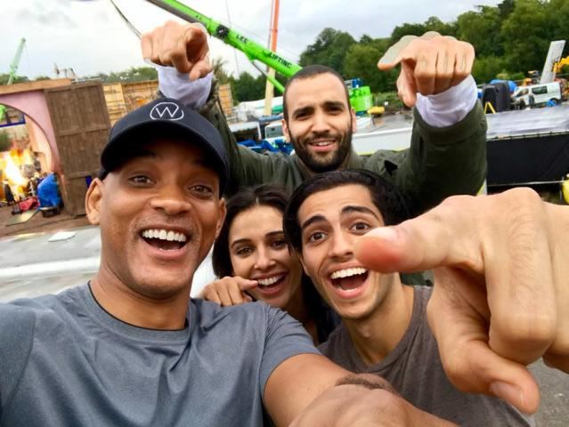 "<p>Wishes do come true! The actor, who is playing the role of Genie in the live-action version of Disney's <em>Aladdin </em>that Robin Williams originally made famous in the animated film, shared the first photo from the set. ""We just started shooting <em>Aladdin</em> and I wanted to intro you guys to our new family — Mena Massoud/Aladdin, Naomi Scott/Princess Jasmine, Marwan Kenzari/Jafar,"" he wrote. ""And I'm over here gettin my Genie on. Here we go!"" (Photo: <a href=""https://www.facebook.com/92304305160/photos/a.231136370160.270995.92304305160/10159146683900161/?type=3&theater"" rel=""nofollow noopener"" target=""_blank"" data-ylk=""slk:Will Smith via Facebook"" class=""link rapid-noclick-resp"">Will Smith via Facebook</a>) </p>"