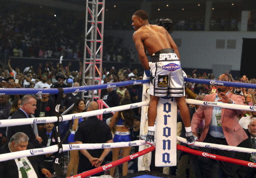 Errol Spence Jr. stands the ropes after Carlos Ocampo was counted out as the first round of the IBF welterweight tile boxing match was ending Saturday, June 16, 2018, in Frisco, Texas. (AP Photo/Richard W. Rodriguez)