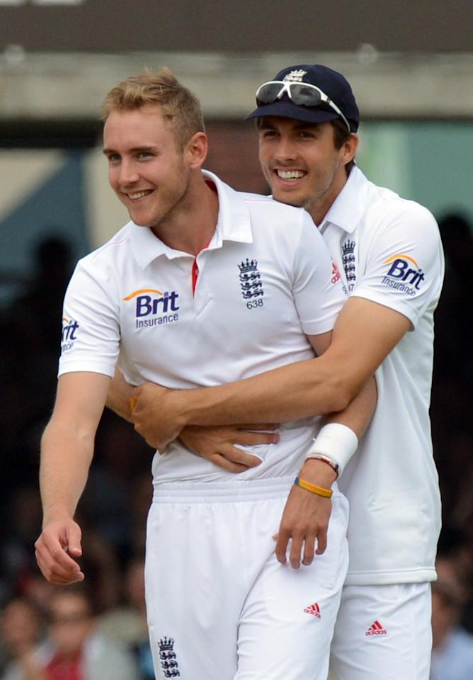 England's Stuart Broad (left) is congratulated by Steven Finn after taking the wicket of New Zealand's Tim Southee for 7 during the first test at Lord's Cricket Ground, London.