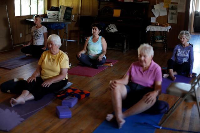 <p>Immigrant Rosa Sabido, 53, (C) takes part in a yoga class in the United Methodist Church in which she lives while facing deportation in Mancos, Colo., July 19, 2017. (Photo: Lucy Nicholson/Reuters) </p>