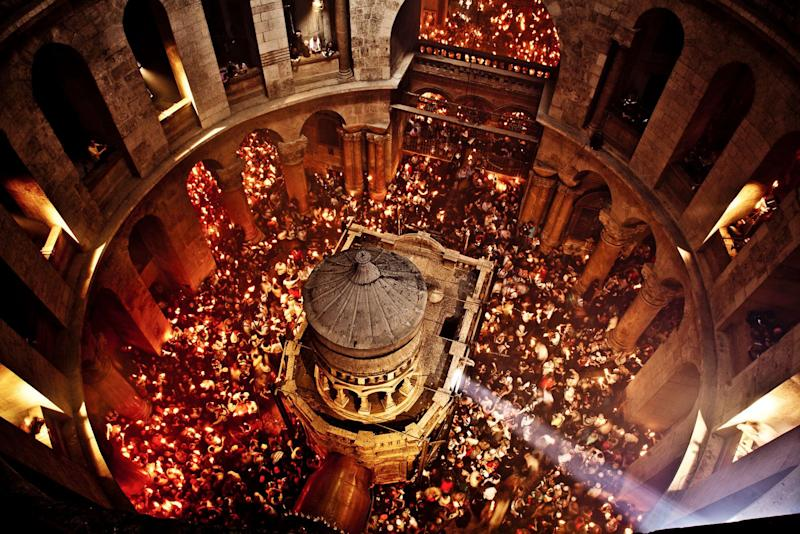 The Ceremony of the Holy Fire takes place every year on the Saturday before Easter in the Church of the Holy Sepulchre. Meant to symbolize the resurrection of Jesus, it is considered by many Orthodox Christians to be the longest-attested annual miracle in the Christian world. This extraordinary image was shot from high up in the rotunda of the Church of Holy Sepulchre during the Ceremony of the Holy Fire. Thousands of candles are lit off a single flame that emerges from the Edicule. Within minutes the entire dome is filled with smoke. (Image exclusive to The Huffington Post)