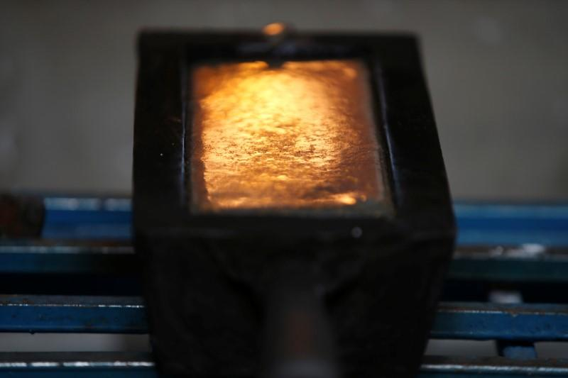 A gold ingot is seen during the refining process at AGR (African Gold Refinery) in Entebbe