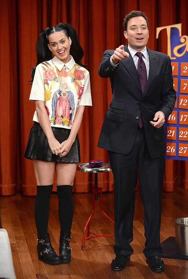 "<p>Perry was the picture of a Catholic schoolgirl during a 2013 stop at <em>The Tonight Show Starring Jimmy Fallon</em>. Her pigtails and religious top must have reminded her of growing up the daughter of traveling ministers in an ultra-religious household, where she called deviled eggs ""angel eggs"" and attended Christian schools. (Photo: Theo Wargo/Getty Images) </p>"