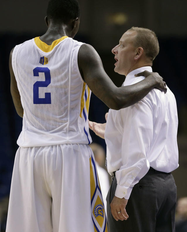 In this Nov. 6, 2013 photo, San Jose State coach Dave Wojcik, right, speaks with Jaleel Williams (2) during a basketball game against Pacific Union, in San Jose, Calif. Wojcik has made so many stops criss-crossing the country for work he began to wonder if he would ever get to be a head coach. On Tuesday night, Nov. 12, 2013, he makes his debut at last when his San Jose State team opens the season at Santa Clara. (AP Photo/Ben Margot)