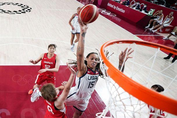 PHOTO: United States' Brittney Griner shoots over Japan's Maki Takada during a women's basketball preliminary round game at the 2020 Summer Olympics, Friday, July 30, 2021, in Saitama, Japan. (Charlie Neibergall/AP Photo)