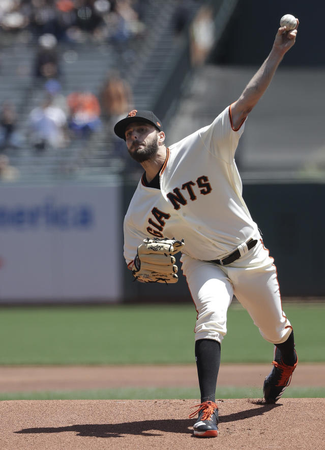 San Francisco Giants pitcher Andrew Suarez throws against the Cincinnati Reds during the first inning of a baseball game in San Francisco, Wednesday, May 16, 2018. (AP Photo/Jeff Chiu)