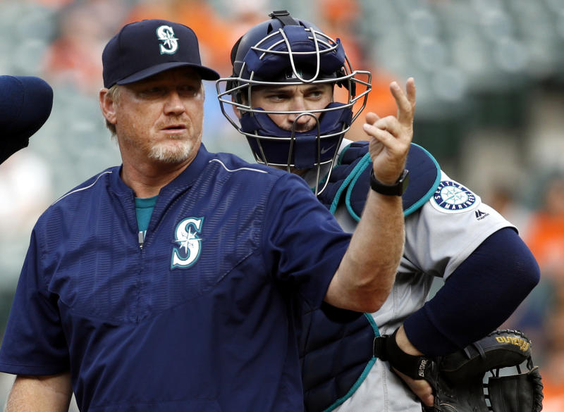 FILE - In this Aug. 30, 2017, file photo, Seattle Mariners pitching coach Mel Stottlemyre, left, motions for manager Scott Servais to come to the mound during the sixth inning of a baseball game against the Baltimore Orioles in Baltimore. New pitching coach Stottlemyr, whose coaching career in professional baseball began in 2002, said the Marlins situation is unique in his experience. (AP Photo/Patrick Semansky, File)