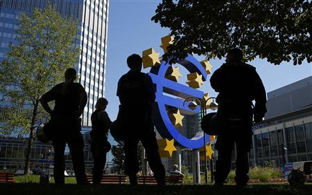 German riot police stand in front of the euro sign during a demonstration by Alternative fuer Deutschland outside ECB headquarters in Frankfurt