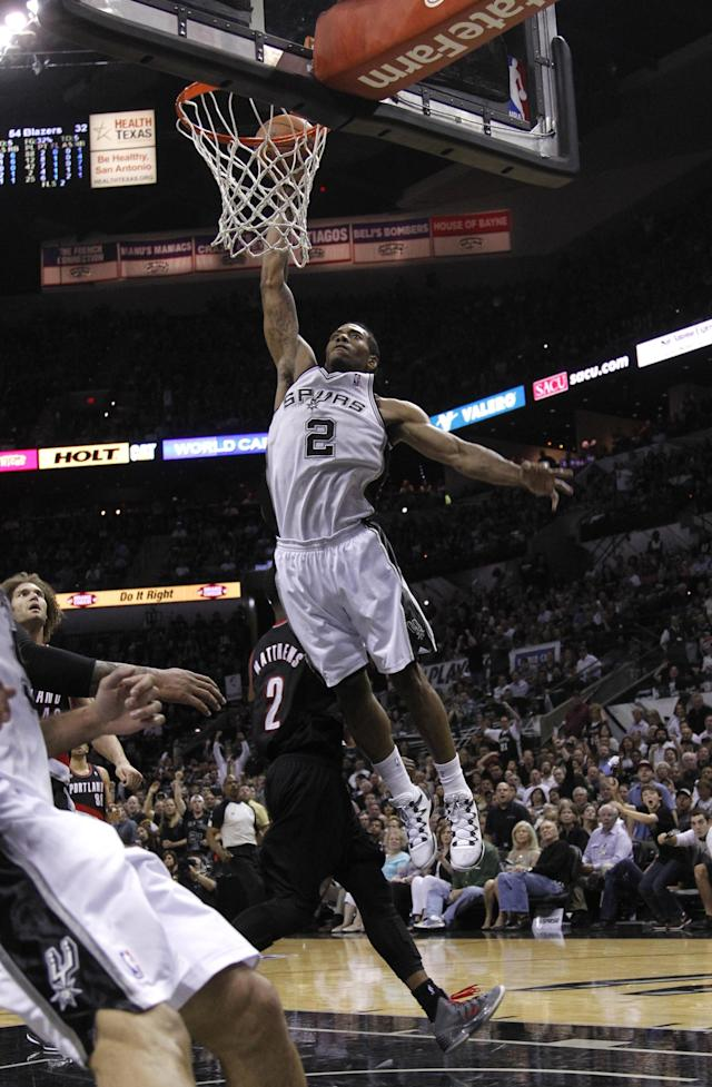 SAN ANTONIO, TX - MAY 6: Kawhi Leonard #2 of the San Antonio Spurs dunks shoots against the Portland Trail Blazers in Game One of the Western Conference Semifinals during the 2014 NBA Playoffs at the AT&T Center on May 6, 2014 in San Antonio, Texas. NOTE TO USER: User expressly acknowledges and agrees that, by downloading and/or using this photograph, user is consenting to the terms and conditions of the Getty Images License Agreement. (Photo by Chris Covatta/Getty Images)
