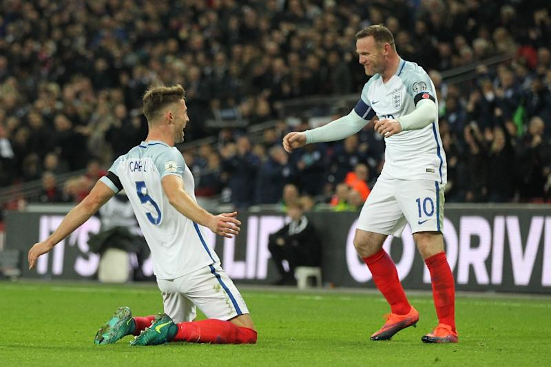 England's defender Gary Cahill (L) celebrates with England's striker Wayne Rooney after scoring their third goal during a World Cup 2018 qualification match between England and Scotland at Wembley stadium in London on November 11, 2016