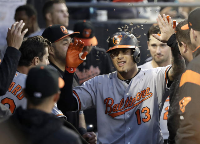 Baltimore Orioles' Manny Machado celebrates in the dugout after his home run off Chicago White Sox's Hector Santiago during the fourth inning of a baseball game Monday, May 21, 2018, in Chicago. (AP Photo/Charles Rex Arbogast)