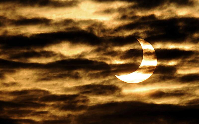 Image result for Here's what the partial solar eclipse looked like over Eastern Asia