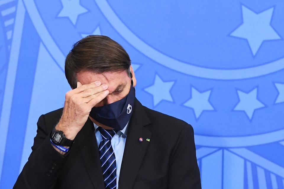 Brazilian President Jair Bolsonaro gestures as he attends the signing ceremony of the Provisional Measure to improve the business environment in Brazil, at Planalto Palace in Brasilia, on March 29, 2021. - Bolsonaro faces a severe crisis between his foreign Minister Ernesto Araujo and the National Congress where he is the target of criticism for the way he has conducted the Brazilian foreign policy. (Photo by EVARISTO SA / AFP) (Photo by EVARISTO SA/AFP via Getty Images)