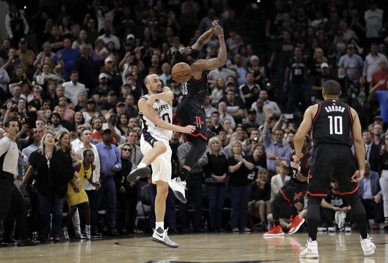 <p>San Antonio Spurs' Manu Ginobili (20) of Argentina blocks Houston Rockets' James Harden three-point shot attempt in the final seconds of overtime of Game 5 in a second-round NBA basketball playoff series, May 9, 2017, in San Antonio. San Antonio won 110-107. (Photo: Eric Gay/AP) </p>
