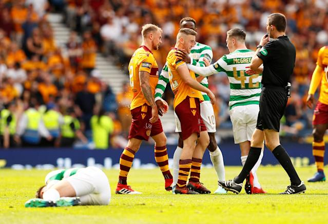 Soccer Football - Scottish Cup Final - Celtic vs Motherwell - Hampden Park, Glasgow, Britain - May 19, 2018 Celtic's Callum McGregor clashes with Motherwell's Allan Campbell after a foul on Kieran Tierney (foreground) Action Images via Reuters/Jason Cairnduff