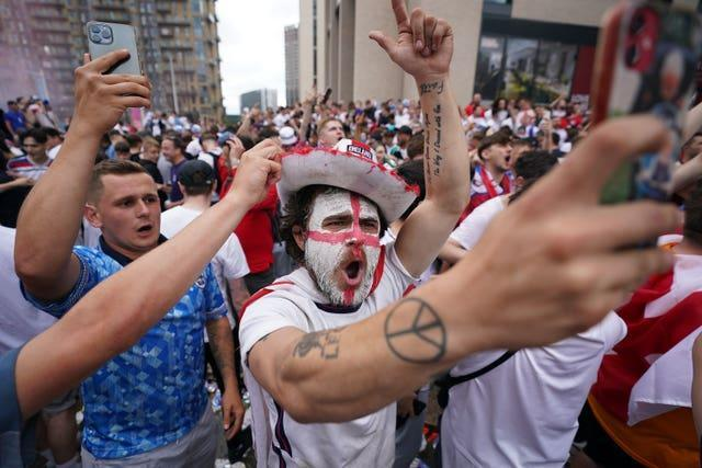 Fans have painted their faces in the nation's colours to show their support (Zac Goodwin/PA)