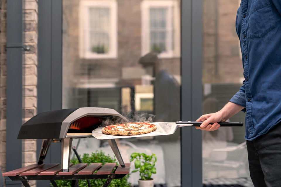 This photo provided by Riverbend Home shows the handy Ooni Koda propane pizza grill, that's ready to go in 15 minutes and cooks pizza in about a minute – as well as roasted fish, steak or vegetables. (Ooni Koda/Riverbend Home via AP)