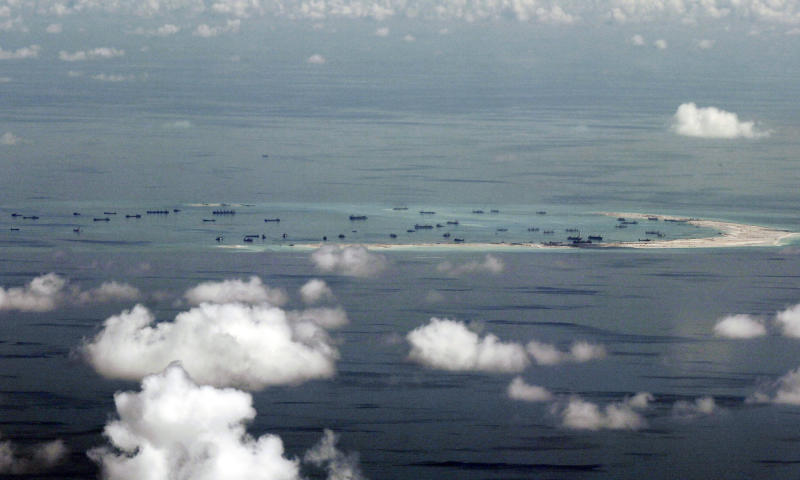 FILE - This May 11, 2015, file photo, shows land reclamation of Mischief Reef in the Spratly Islands in the South China Sea. China has reportedly deployed a Zeppelin-like airship to Mischief Reef in the South China Sea. (Ritchie B. Tongo/Pool Photo via AP, File)