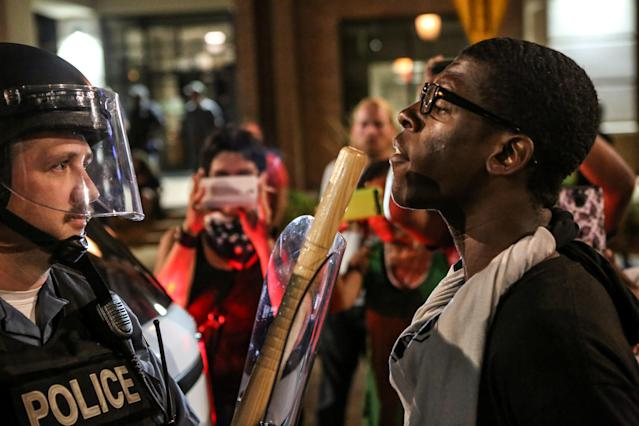 <p>A protester confront police during the second night of demonstrations after a not guilty verdict in the murder trial of former St. Louis police officer Jason Stockley, charged with the 2011 shooting of Anthony Lamar Smith, who was black, in St. Louis, Mo., Sept. 16, 2017. (Photo: Lawrence Bryant/Reuters) </p>