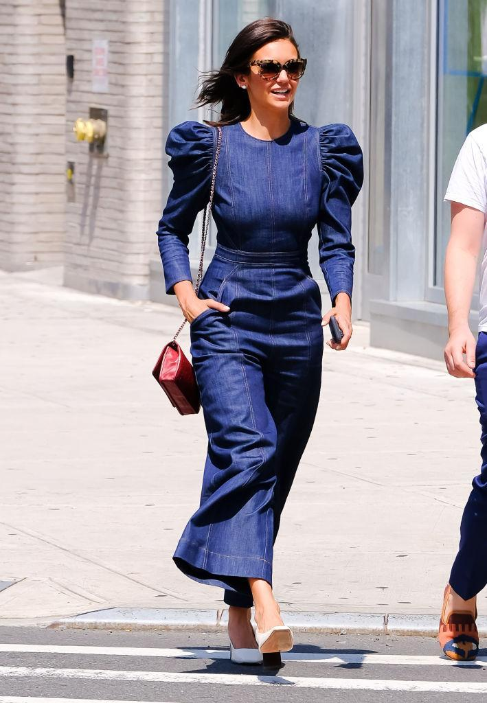 <p>Nina Dobrev wears an Ulla Johnson '80s-style puffy-shoulder denim jumpsuit on Aug. 8, 2018, in New York City. (Photo: Raymond Hall/GC Images) </p>
