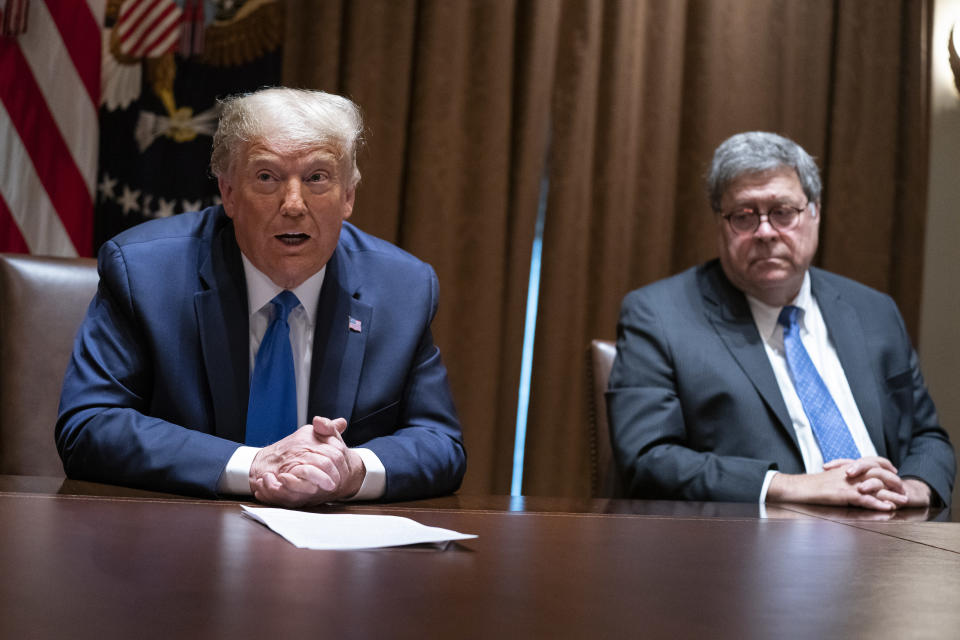 FILE - In this Sept. 23, 2020, file photo Attorney General William Barr listens as President Donald Trump speaks during a meeting with Republican state attorneys general in the Cabinet Room of the White House in Washington. The relationship between President Donald Trump and top ally Attorney General William Barr is fraying over the lack of splashy indictments so far in the Justice Department's investigation into the origins of the Russia probe, according to people familiar with the matter. (AP Photo/Evan Vucci, File)