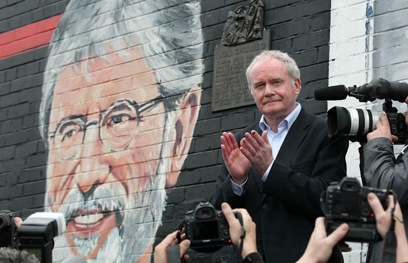 Northern Ireland's late deputy first minister Martin McGuinness speaks at a rally in support of Sinn Fein leader Gerry Adams in Belfast in May 2014 (AFP Photo/PETER MUHLY)