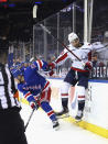 New York Rangers' Adam Fox (23) backs into Washington Capitals' Tom Wilson (43) during the first period of an NHL hockey game Wednesday, May 5, 2021, in New York. (Bruce Bennett/Pool Photo via AP)