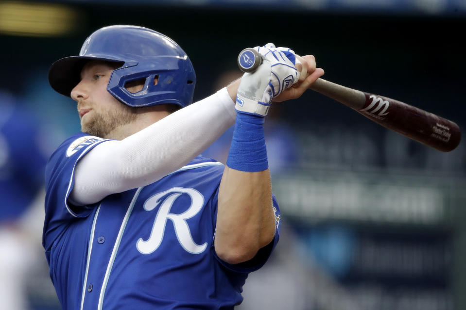 Kansas City Royals' Hunter Dozier bats during the first inning of an exhibition baseball game against the Houston Astros in Kansas City, Mo., Monday, July 20, 2020. (AP Photo/Charlie Riedel)