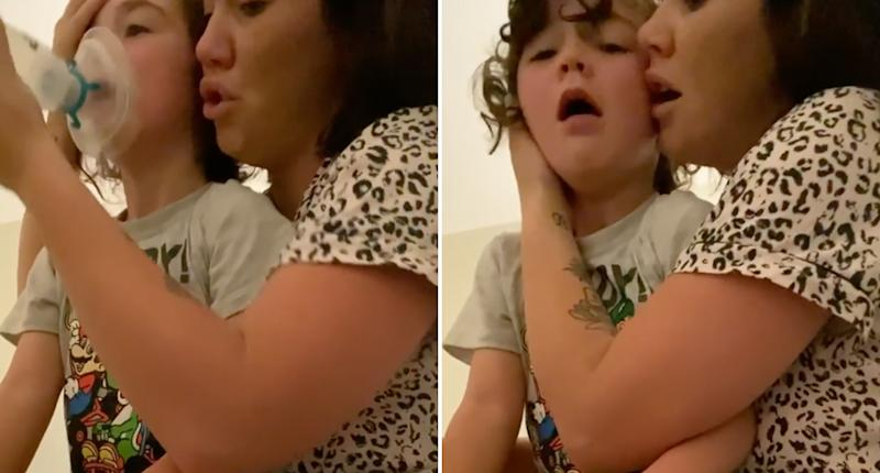 Sophie Cachia holds her son Bobby, 6, as he has an asthma attack.