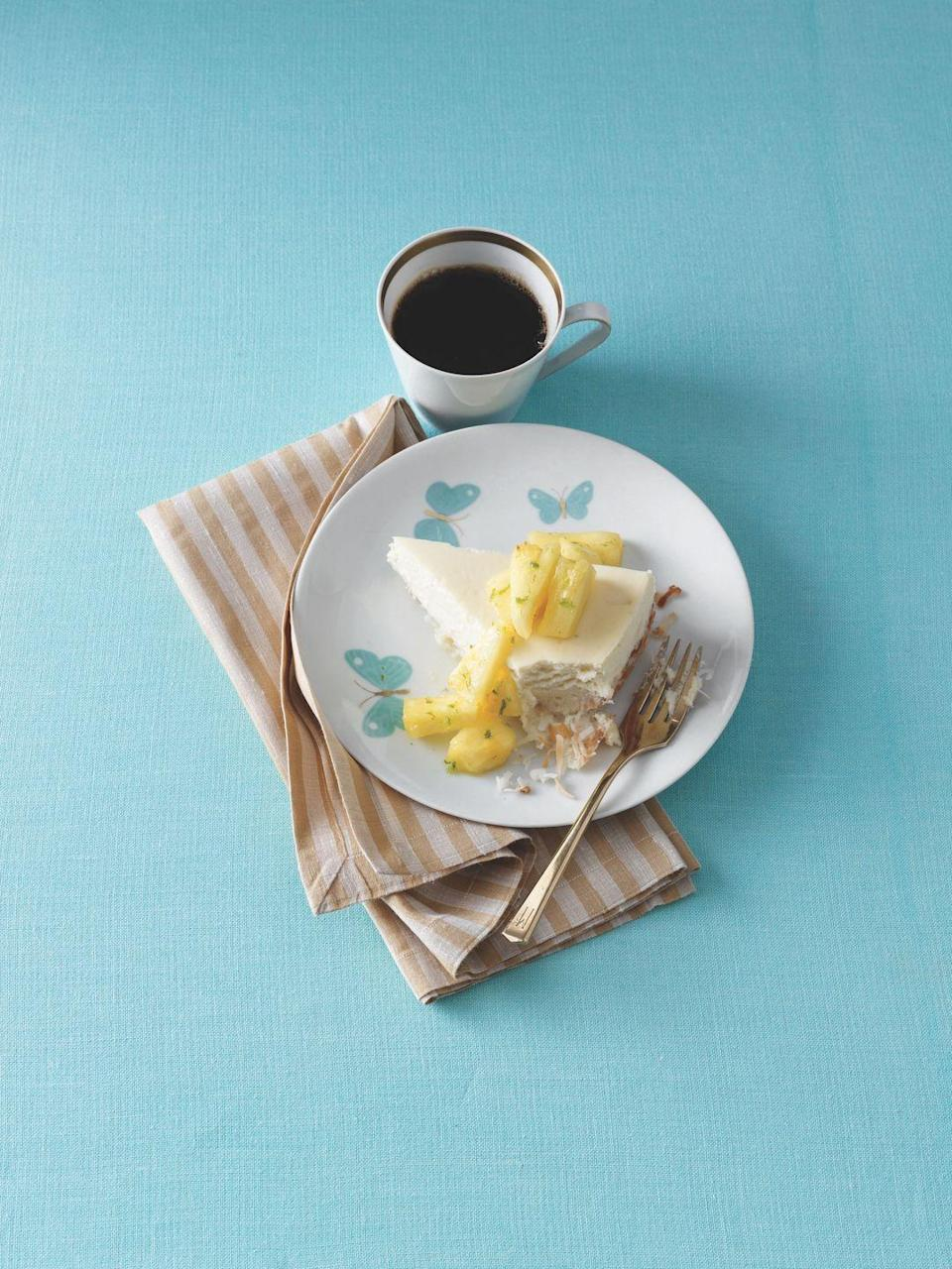 """<p>Pineapple is the perfect pairing to this lush cheesecake, set on a macaroon crust made of coconut, egg whites, and sugar.</p><p><em><a href=""""https://www.womansday.com/food-recipes/food-drinks/recipes/a11279/cheesecake-macaroon-crust-recipe-122896/"""" rel=""""nofollow noopener"""" target=""""_blank"""" data-ylk=""""slk:Get the recipe from Woman's Day »"""" class=""""link rapid-noclick-resp"""">Get the recipe from Woman's Day »</a></em></p>"""