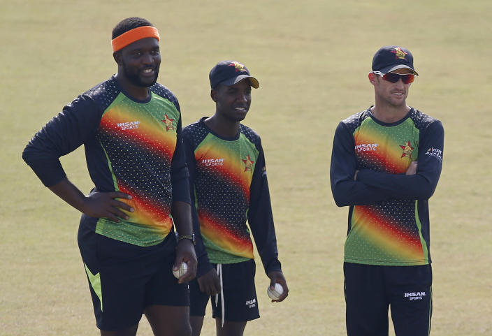 Zimbabwe cricket team players, left to right, Tendai Chisoro, Donald Tiripano and Sean Williams attend a practice session at the Pindi Cricket Stadium, in Rawalpindi, Pakistan, Tuesday, Oct. 27, 2020. Zimbabwe cricket team is in Pakistan to play three ODIs and three Twenty20 International match series,that begin with the first ODI on Friday. (AP Photo/Anjum Naveed)