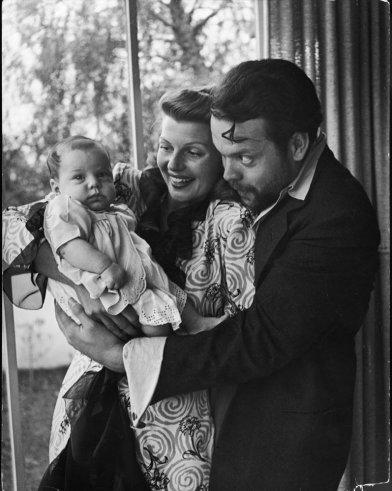 "Orson Welles, wife Rita Hayworth and daughter Rebecca at home in 1945. <br><br><br><a href=""http://life.time.com/news/fathers-day-special-life-with-famous-dads/#1"">Click here</a> to see the full collection at LIFE.com…"