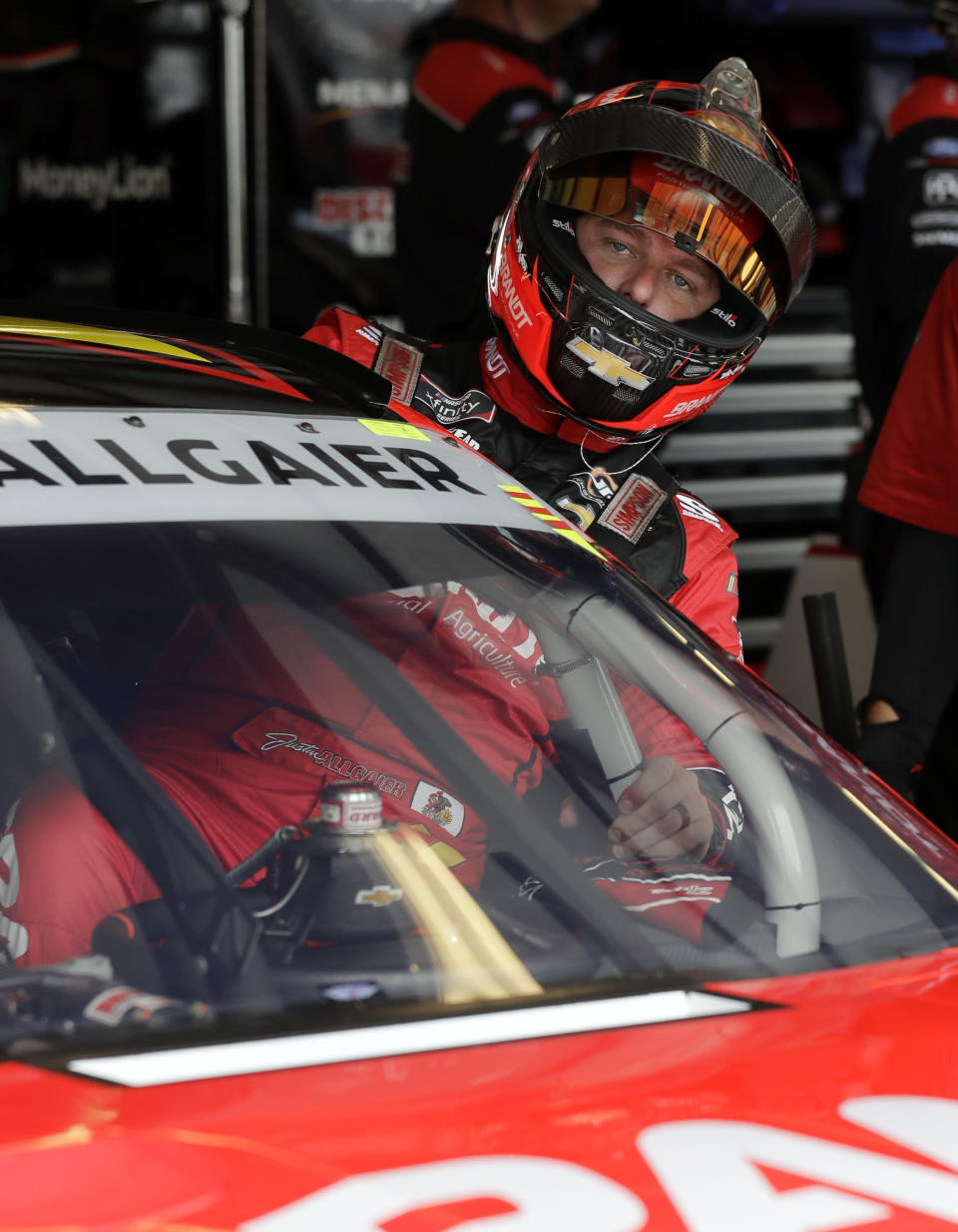 Justin Allgaier climbs into his car during a NASCAR Xfinity Series auto race practice at Chicagoland Speedway in Joliet, Ill., Friday, June 28, 2019. (AP Photo/Nam Y. Huh)