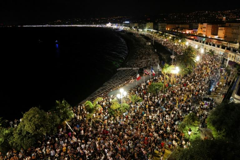 Crowds massing on Nice's  Promenade des Anglais esplanade for electro house music producer The Avener's set